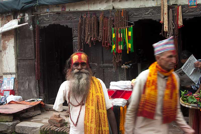 nepal_potraits_one-armed-priest-blur_loxley-browne-photography