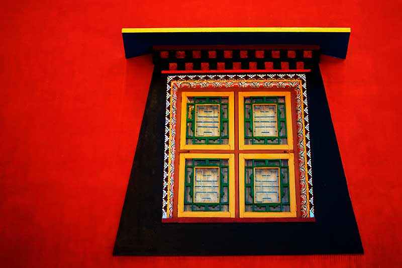 nepal_red-wall-window_loxley-browne-photography